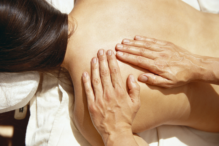 Massaging Woman's Back